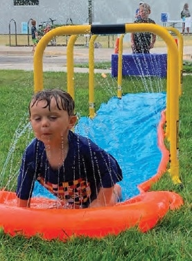 Tucker Blue enjoys the water games at the Kids Quest Finale.