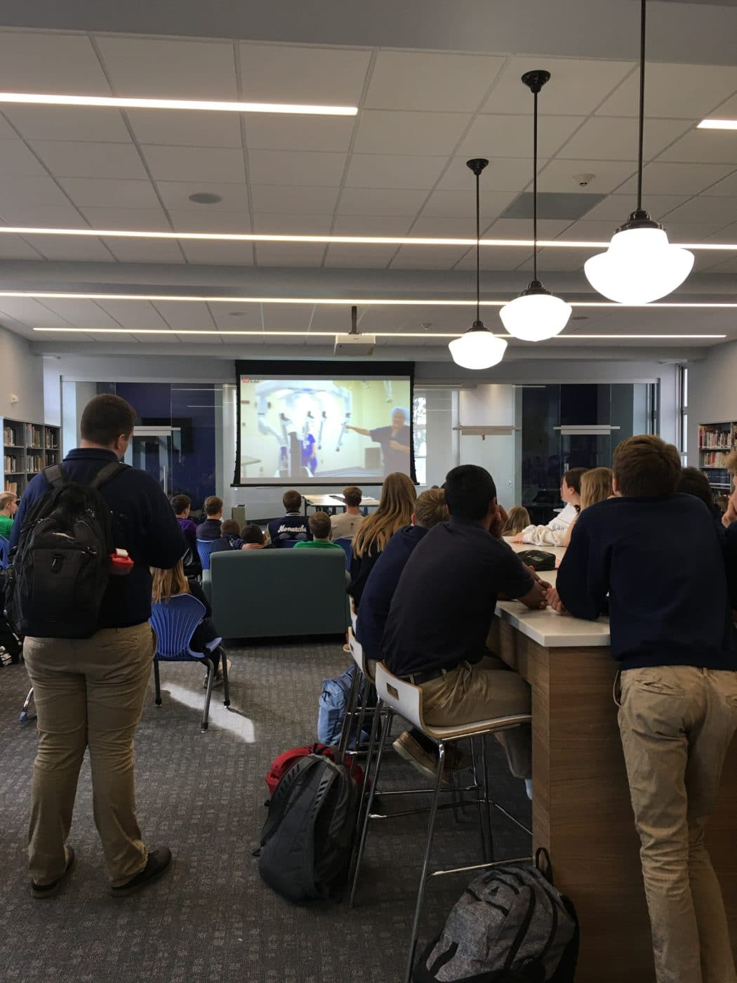 Courtesy Photo | Students at Thomas More Prep-Marian Junior/Senior High in Hays watch the live demonstration in their new learning commons.