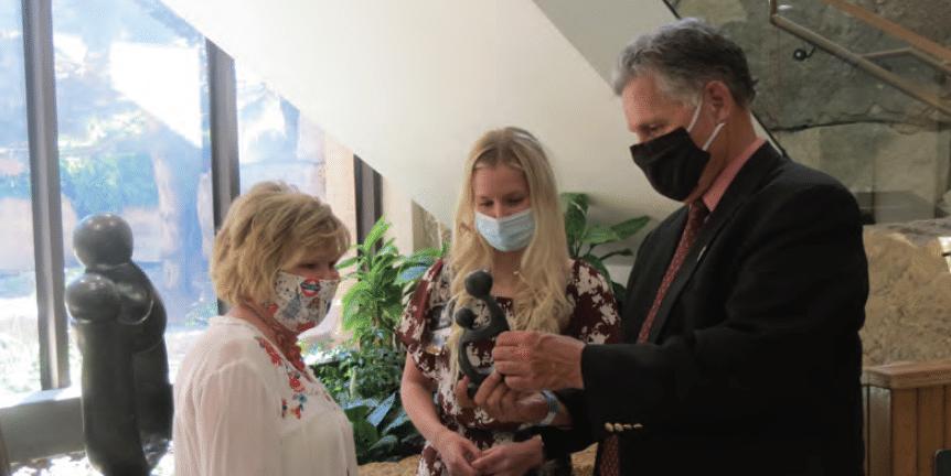 Nancy and Bill Jeter congratulate HaysMed's newest Daisy Award Winner Omelia Klein.